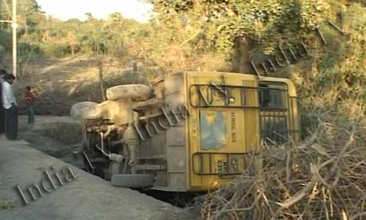 indore school bus with 60 children falls into drain