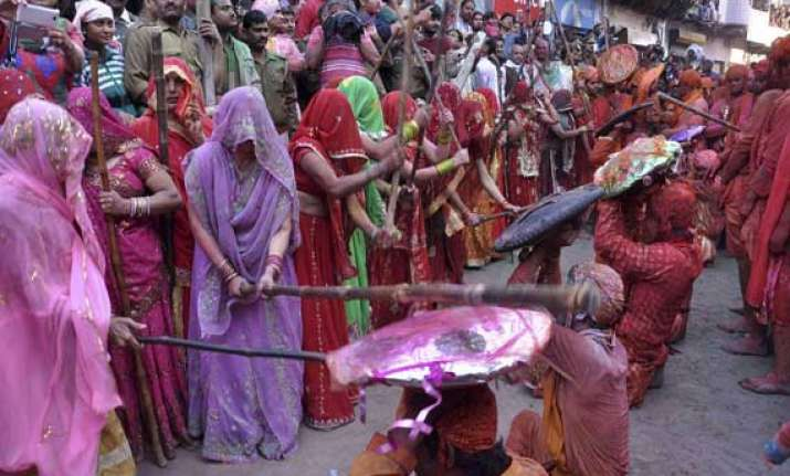 know about lathmar holi of barsana when women beat men with