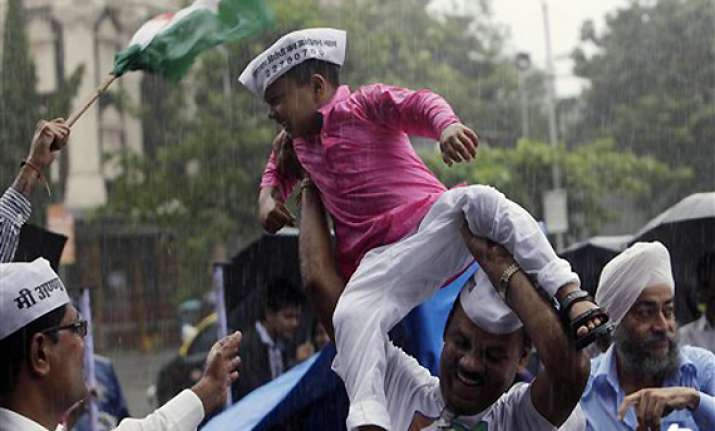jubilant hazare supporters call it a victory of common man