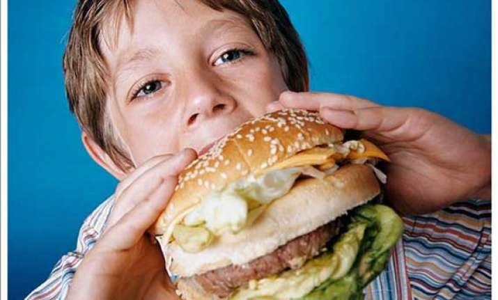 junk food causing puberty to hit at age 6 experts
