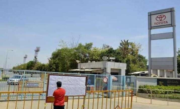 karnataka orders toyota union to restore normalcy