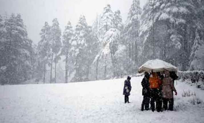 kashmir valley lashed by rains higher reaches receive snow