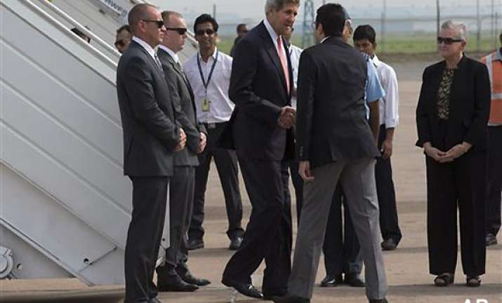 kerry lands in india climate change business on top