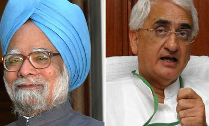khurshid speaks to pm after ec complains to president