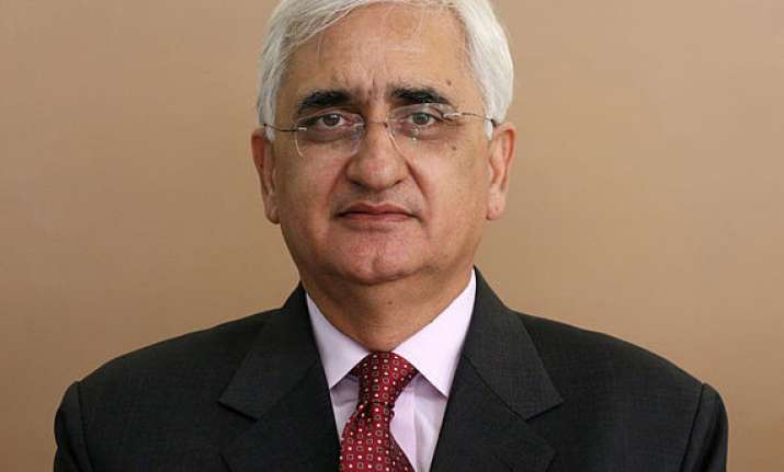 khurshid tightlipped on ec s move against him