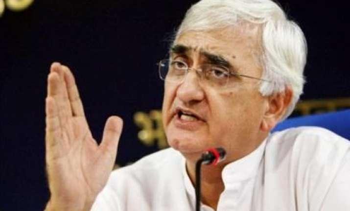 khurshid asks hazare to bring movement on track slams team