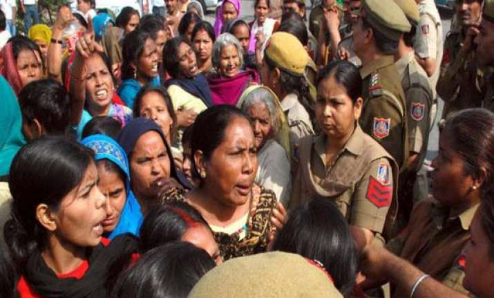 locals protest outside alipur police station in delhi over