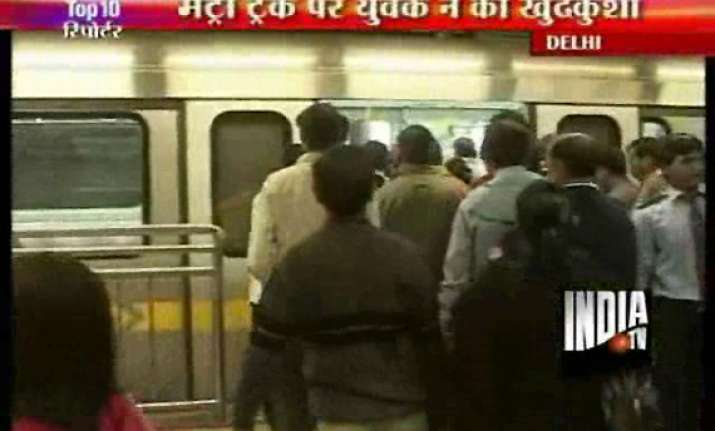 man jumps before metro train