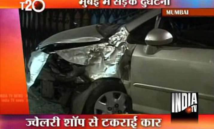 man runs over honda city car over mumbai pavement rams into