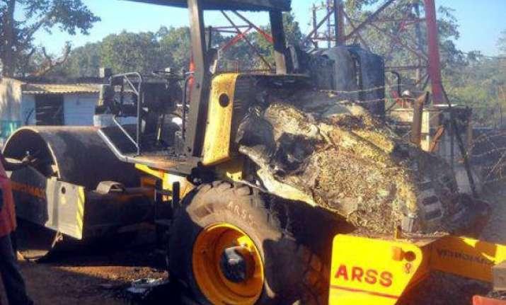 maoists set on fire excavator machine