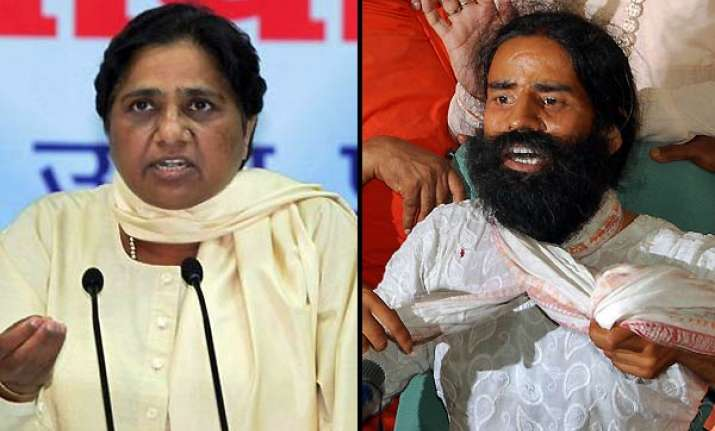 mayawati demands sc probe into police action on ramdev