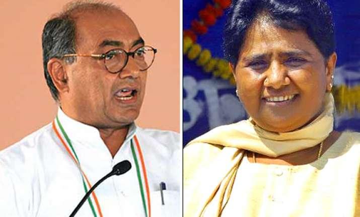 mayawati feeling threatened by congress says digvijay