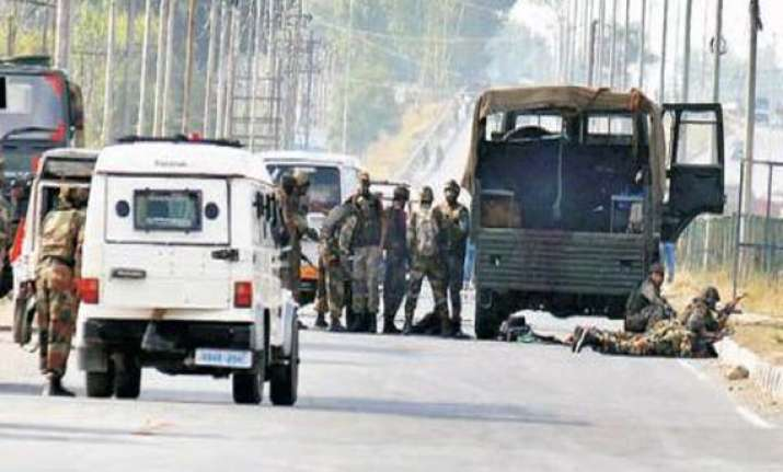 militant fires at mini bus 4 wounded