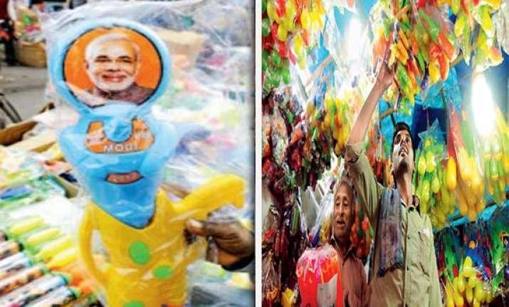 modi kejriwal pichkari battle hots up before holi