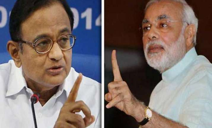 modi alleges distribution of watches with chidambaram s pics