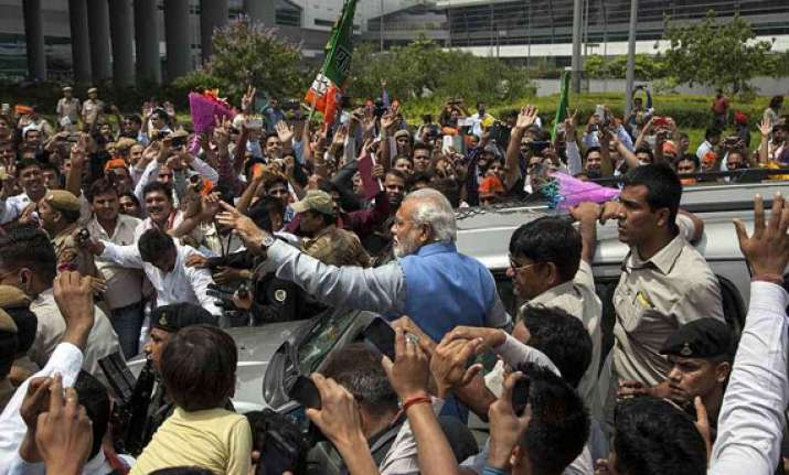modi holds roadshow in delhi amidst cheering crowds