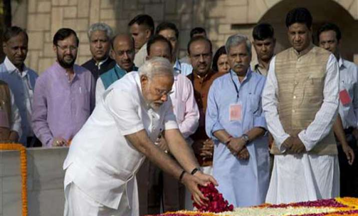 narendra modi pays homage to mahatma gandhi at rajghat