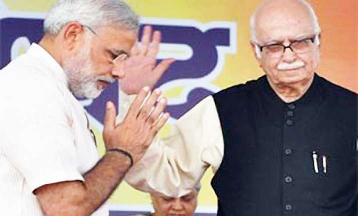 modi breaks silence on tiff with advani praises yatra