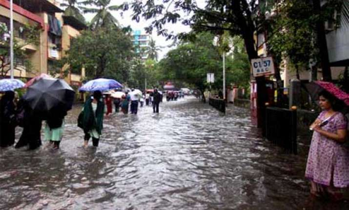 heavy rains paralyse life in mumbai road rail traffic hit