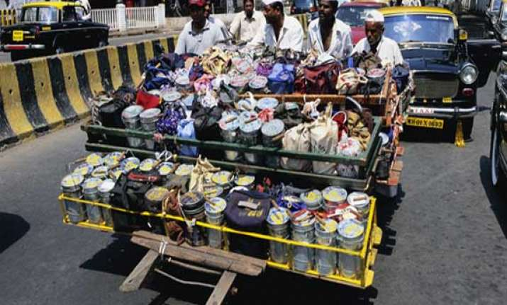 mumbai dabbawalas hike delivery charges to meet rising