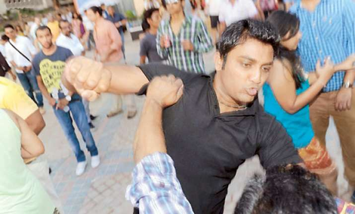 mumbai bouncer held for beating up photographers in hotel