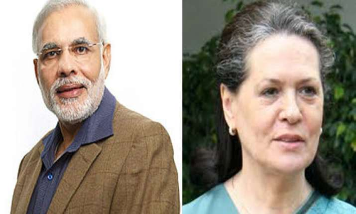 narendra modi dares sonia for public debate on gujarat