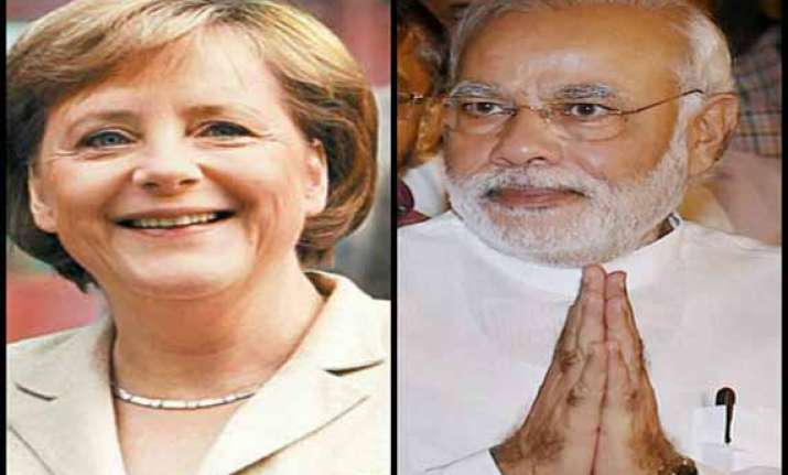 narendra modi speaks to merkel invites her to visit india