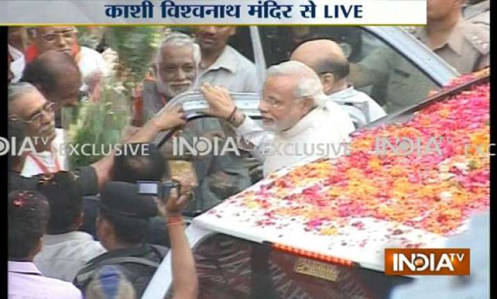 narendra modi visits varanasi offers prayers