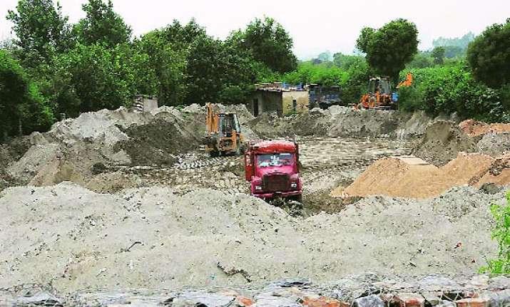 national green tribunal restrains illegal sand mining