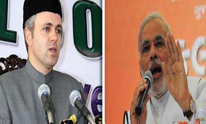 omar blames modi for inciting violence in assam