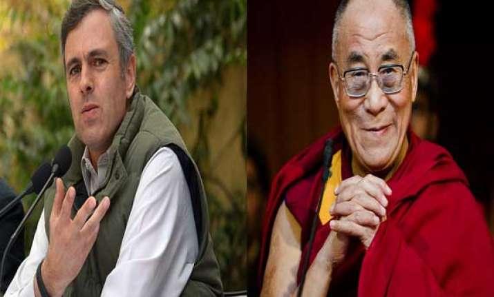 omar welcomes dalai lama at kalachakra 2014
