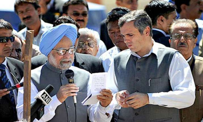 omar meets pm over afspa issue