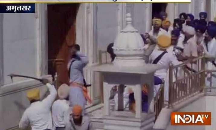 uneasy calm at golden temple complex after violent clash