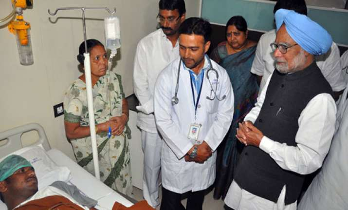 pm visits terror hit hyderabad lends healing touch