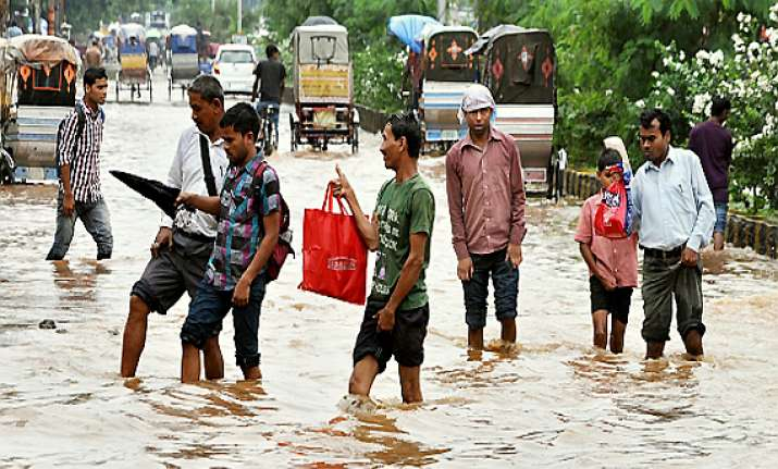 pm announces rs one lakh each for deceased in assam flood