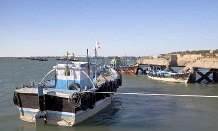 pak national held three boats seized near harami nala in guj