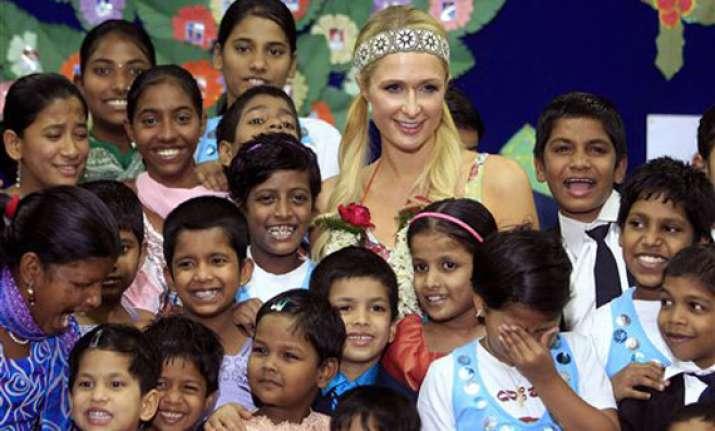 paris hilton dances with orphans prays at siddhivinayak