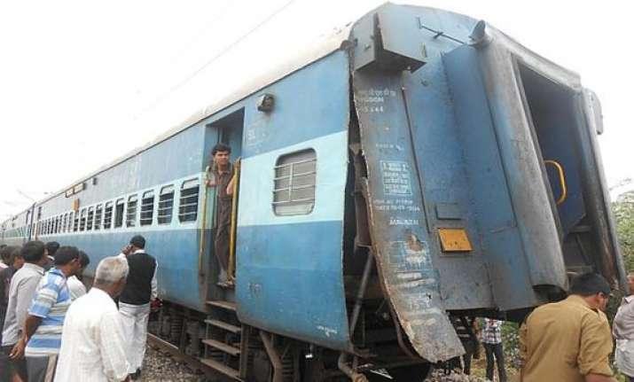 passenger train proceeds leaving few coaches behind