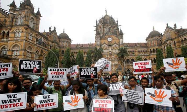 photojournalist rape cops move court for transfer of warrant