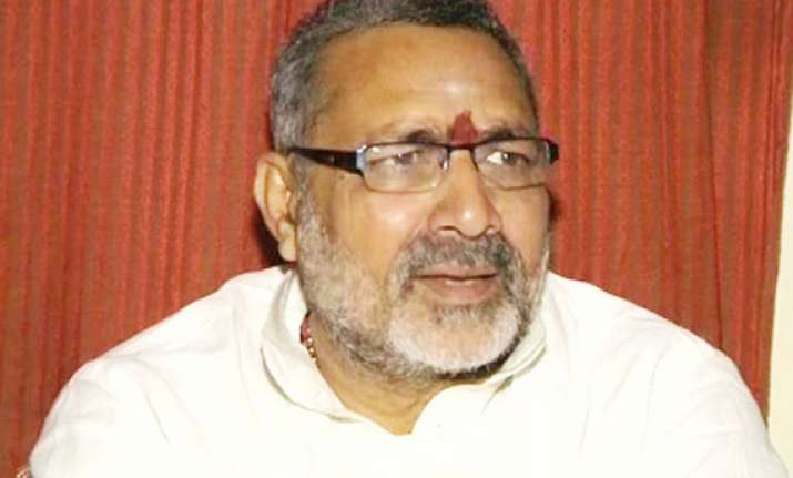 police raids giriraj singh s home to arrest him