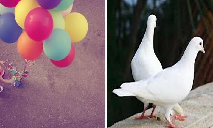 political activists send love balloons and white pigeons on