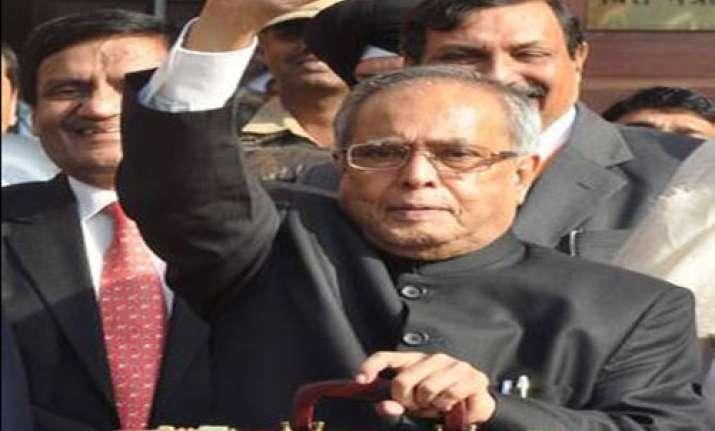 pranab doles out tax sops casts service tax wider