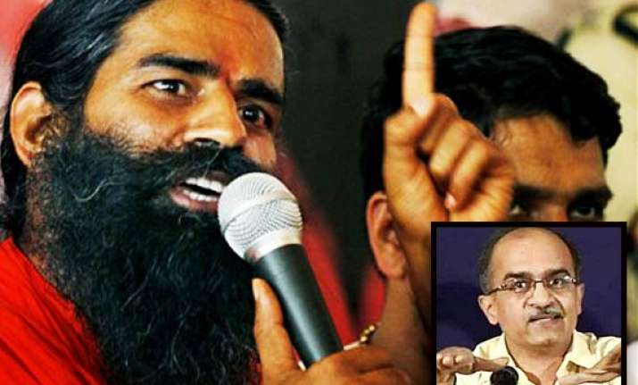 prashant bhushan objects to sadhvi sharing dais with ramdev