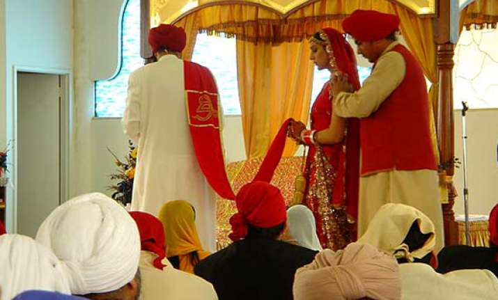 president signs bill on sikh marriage registration