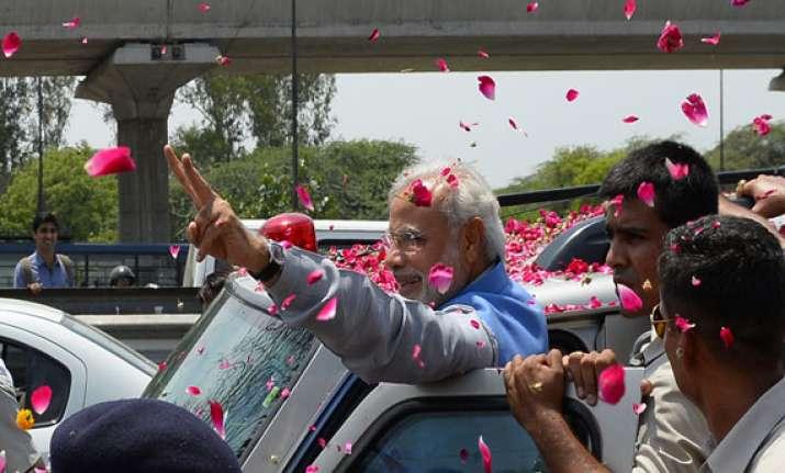 prime minister designate modi gets grand welcome at airport