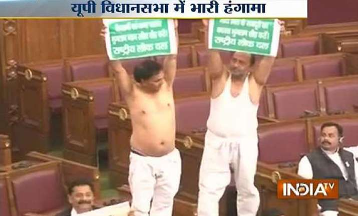 rld legislators take off their shirts in up assembly