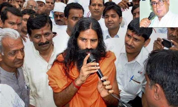 rss behind ramdev fast says digvijay