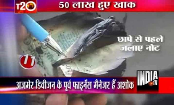 railway officer caught burning rs 2.5 lakh cash bribe