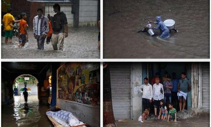 rains disrupt life in mumbai watch pics