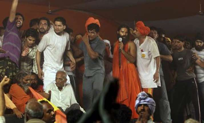 ramdev says his fast continues gives call for black day